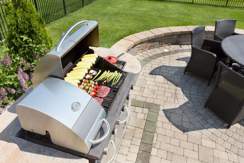 outdoor kitchen with concrete brick floor