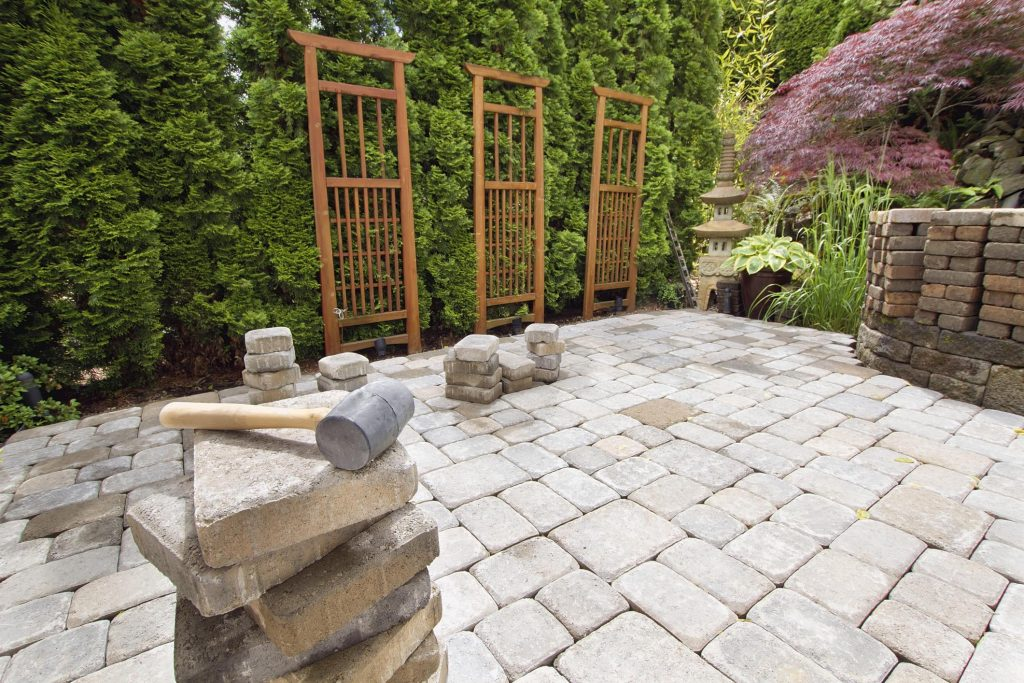concrete bricks for patio surrounded with landscapes